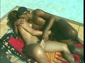 Gorgeous shemale shows off her tight round ass poolside